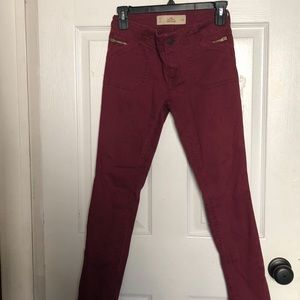 HOLLISTER: low rise burgundy skinny jeans
